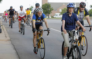 Photo -  Bicyclists pedal down Second Street during the 2012 Bike To Work Day in Edmond. Photo by Paul B. Southerland, The Oklahoman Archives  <strong>PAUL B. SOUTHERLAND -   </strong>