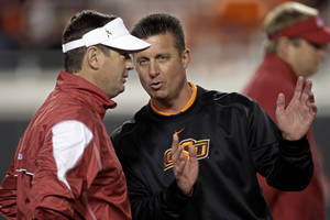 Photo - Oklahoma's Bob Stoops and Oklahoma State's Mike Gundy are two of the most well-paid coaches in college football.