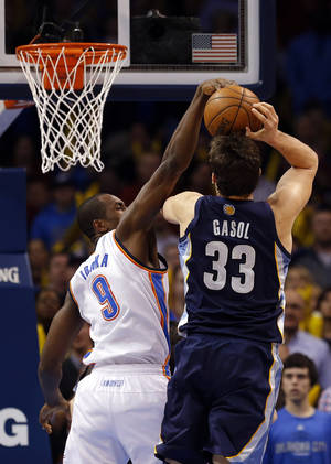 Photo - Oklahoma City's Serge Ibaka (9) blocks the shot of Memphis' Marc Gasol (33) during the NBA basketball game between the Oklahoma City Thunder and the Memphis Grizzlies at the Chesapeake Energy Arena in Oklahoma City,  Thursday, Jan. 31, 2013.Photo by Sarah Phipps, The Oklahoman