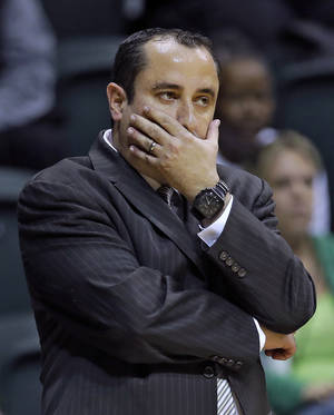 Photo - South Florida head coach Jose Fernandez reacts during the first half of an NCAA college basketball game against Louisville, Sunday, Jan. 12, 2014, in Tampa, Fla. Louisville won the game 62-54. (AP Photo/Chris O'Meara)