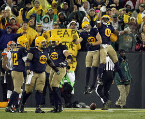 Photo - Green Bay Packers' Jordy Nelson (87) celebrates his touchdown catch with teammate Jarrett Boykin (11) during the second half of an NFL football game against the Cleveland Browns Sunday, Oct. 20, 2013, in Green Bay, Wis. The Packers won 31-13. (AP Photo/Mike Roemer)