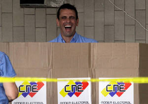 photo - Miranda State's Gov. Henrique Capriles laughs while casting his ballot at a polling station in Caracas, Venezuela, Sunday, Dec. 16, 2012. Venezuelans are choosing governors and state lawmakers  in elections that have become a key test of whether President Hugo Chavez's movement can endure if the socialist leader leaves the political stage. The vote is the first time in Chavez's nearly 14-year-old presidency that he has been unable to actively campaign. He hasn't spoken publicly since undergoing cancer surgery on Tuesday in Cuba. (AP Photo/Fernando Llano)