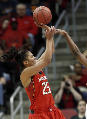 Photo - Maryland forward Alyssa Thomas (25) shoots during the second half of a regional semifinal game against Tennessee at the NCAA college basketball tournament on Sunday, March 30, 2014, in Louisville, Ky. (72-63 AP Photo/John Bazemore)