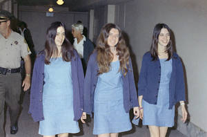 Photo - FILE - Charles Manson followers, from left: Susan Atkins, Patricia Krenwinkel and Leslie Van Houten, shown walking to court to appear for their roles in the 1969 cult killings of seven people, including pregnant actress Sharon Tate, in Los Angeles, Calif., in this Aug. 20, 1970 file photo. 44 years after she went to prison, Leslie Van Houten is an old woman with gray hair and wrinkles and she is facing her 20th parole hearing Wednesday June 5, 2013 with multiple forces arrayed against her bid for a chance at freedom in her old age. (AP Photo/George Brich, File)