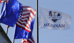 photo -   A flag flies over the Medinah Country Club before the Ryder Cup PGA golf tournament Monday, Sept. 24, 2012, in Medinah, Ill. (AP Photo/Charlie Riedel)