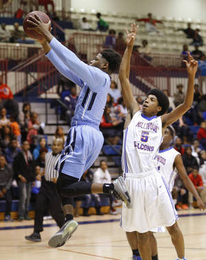 Photo - The Storm's Chauncey Collins goes to the basket past Millwood's Ashford Golden during their boys high school basketball game at Millwood in Oklahoma City, Tuesday, Feb., 11, 2014. Photo by Bryan Terry, The Oklahoman
