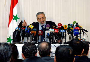 Photo - In this photo released by the Syrian official news agency SANA, Syrian Information Minister Omran al-Zoubi speaks during a press conference in Damascus, Syria, Sunday, Dec. 23, 2012. Al-Zoubi said, the Syrian government's line that it is fighting terrorist groups backed by foreign powers who seek to destroy Syria, he equated the rebels with al-Qaida and denied that they had taken over any territory and said the government was willing to engage in dialogue but said the other side wasn't. (AP Photo/SANA)