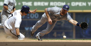 photo -   Milwaukee Brewers&#039; Norichika Aoki (7) steals second as San Diego Padres&#039; Logan Forsythe misses the throw during the sixth inning of a baseball game, Sunday, June 10, 2012, in Milwaukee. (AP Photo/Jim Prisching)  
