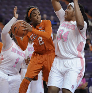 Photo - Clemson's Chelsea Lindsay (2) is pressured by North Carolina State's Markeisha Gatling during the first half of an NCAA college basketball game Thursday, Feb. 13, 2014, at Littlejohn Coliseum in Clemson, S.C. (AP Photo/Richard Shiro)