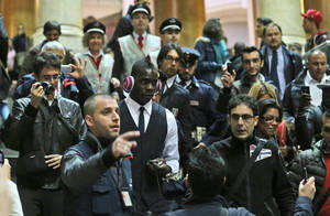 Photo -   Italy forward Mario Balotelli, center with pink headphones, arrives at Milan's Central station, Italy, Monday, Oct. 15, 2012, in preparation for the World Cup Group B qualifying soccer match against Denmark scheduled for Tuesday. (AP Photo/Luca Bruno)