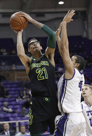 Photo - Baylor center Isaiah Austin (21) shoots against TCU forward Amric Fields (4) during the first half of an NCAA college basketball game Wednesday, Feb. 12, 2014, in Fort Worth, Texas. (AP Photo/LM Otero)
