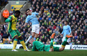 Photo - Norwich City's goalkeeper John Ruddy saves at the feet of Manchester City's Gonzalez Jesus Navas during the English Premier League match at Carrow Road, Norwich Saturday Feb.  8, 2014. (AP Photo/ Chris Radburn/PA) UNITED KINGDOM OUT - NO SALES - NO ARCHIVES