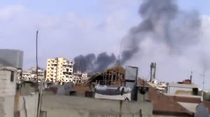 Photo -   In this image taken from video obtained from the Shaam News Network, which has been authenticated based on its contents and other AP reporting, smoke rises from houses due to government shelling in Homs, Syria, on Friday, Oct. 5, 2012. (AP Photo/Shaam News Network via AP video)