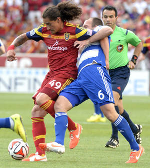 Photo - Real Salt Lake forward Devon Sandoval (49) gets tangled up with FC Dallas midfielder Adam Moffat (6) during an MLS soccer game on Saturday, May 24, 2014, in Sandy, Utah. (AP Photo/The Salt Lake Tribune, Rick Egan) LOCAL TV OUT; MAGAZINES OUT; DESERET NEWS OUT