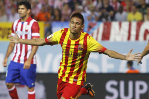 Photo - Barcelona's Neymar from Brazil, second left, celebrates his goal during a Spain Super Cup soccer match against Atletico de Madrid at the Vicente Calderon stadium in Madrid, Spain, Wednesday, Aug. 21, 2013. (AP Photo/Andres Kudacki)
