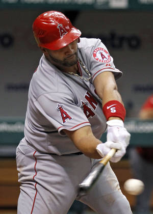 Photo -   Los Angeles Angels' Albert Pujols lines a sixth-inning single off Tampa Bay Rays starting pitcher Matt Moore during a baseball game, Thursday, April 26, 2012, in St. Petersburg, Fla. (AP Photo/Chris O'Meara)