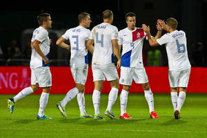 Photo - Netherlands' Robin Van Persie, second right, celebrates with teammates after scoring the first goal during the World Cup Group D qualifying soccer match between Andorra and the Netherlands at the Communal stadium in Andorra la Vella, Andorra, Tuesday, Sept. 10, 2013. (AP Photo/Joan Manuel Baliellas)