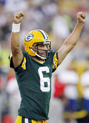 photo -   Green Bay Packers quarterback Graham Harrell celebrates a touchdown run by running back Alex Green during the first half of an NFL preseason football game against the Kansas City Chiefs Thursday, Aug. 30, 2012, in Green Bay, Wis. (AP Photo/Mike Roemer)