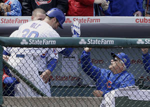 Photo - Chicago Cubs' Mike Olt, left, celebrates with manager Rick Renteria, right, and Anthony Rizzo after hitting a solo home run during the second inning of a baseball game against the Cincinnati Reds in Chicago, Saturday, April 19, 2014. (AP Photo/Nam Y. Huh)