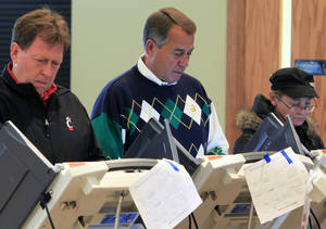 Photo -   Speaker John Boehner, R-Ohio, center, votes at Ronald Reagan Lodge, Tuesday, Nov. 6, 2012, in West Chester, Ohio. After a grinding presidential campaign, Americans head into polling places across the country. (AP Photo/Al Behrman)