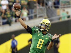 Photo -   Oregon quarterback Marcus Mariota throws during the first half of their NCAA college football game in Eugene, Ore., Saturday, Sept. 1, 2012. (AP Photo/Don Ryan)