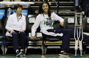 Photo - Notre Dame's Natalie Achonwa and Notre Dame head coach Muffet McGraw watch practice  before the women's Final Four of the NCAA college basketball tournament, Saturday, April 5, 2014, in Nashville, Tenn. Notre Dame will play Maryland Sunday. (AP Photo/Mark Humphrey)