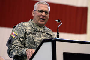 photo - Maj. Gen.l Myles Deering, adjutant general for Oklahoma, addresses troops in March during the return ceremony for the National Guard&#039;s 45th Infantry Brigade Combat Team at the Army Aviation hanger at Will Rogers Air National Guard Base. The Oklahoman Archives