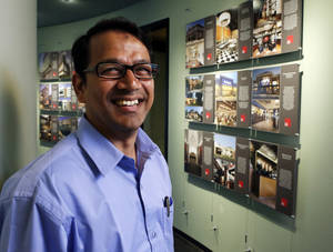 Photo -                    AKM Zabed Rahman, a visiting architectural firm executive from Bangladesh on Wednesday in Norman.                     Photo by Steve Sisney, The Oklahoman