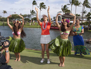 Photo - Michelle Wie, center, dances the hula after winning the 2014 LPGA LOTTE Championship golf tournament at Ko Olina Golf Club, Saturday, April 19, 2014, in Kapolei, Hawaii. (AP Photo/Eugene Tanner)