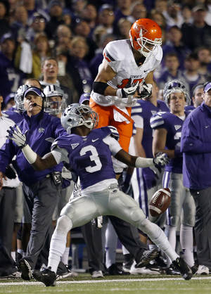 photo - Kansas State's Allen Chapman (3) breaks up a pass intended for Oklahoma State's Charlie Moore (17) during the college football game between Kansas State University (KSU) and Oklahoma State (OSU) at  Bill Snyder Family Football Stadium in Manhattan, Kan.,  Saturday, Nov. 3, 2012. Photo by Sarah Phipps, The Oklahoman