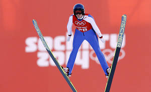 Photo - Austria's Daniela Iraschko-Stolz soars through the air during a women's ski jumping training session at the 2014 Winter Olympics, Saturday, Feb. 8, 2014, in Krasnaya Polyana, Russia. (AP Photo/Matthias Schrader)