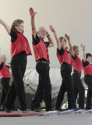 From left, Marti Hole, Fred Cherry, Mary Burleson, Jan Draper and Sharon Graham with The Okie Stompers perform at the annual May Fair Festival Saturday at Andrews Park in Norman. PHOTO BY STEVE SISNEY, THE OKLAHOMAN <strong>STEVE SISNEY</strong>