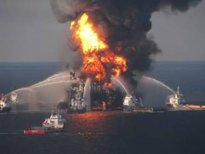 "photo - FILE - In this April 21, 2010 file image provided by the U.S. Coast Guard, fire boat response crews battle the blazing remnants of the off shore oil rig Deepwater Horizon. British oil company BP said Thursday Nov. 15, 2012 it is in advanced talks with U.S. agencies about settling criminal and other claims from the Gulf of Mexico well blowout two years ago. In a statement, BP said ""no final agreement has yet been reached"" and that any such deal would still be subject to court approvals. (AP Photo/US Coast Guard, File)"
