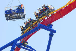 Photo -   Emergency crews bring water to passengers stuck over 150 feet in the air on the top of the new Superman Ultimate Flight roller coaster at Six Flags Discovery Kingdom in Vallejo, Calif., on Sunday, July 29, 2012. Riders were stuck for nearly two hours due to a malfunction. (AP Photo/Times-Herald, Chris Riley)
