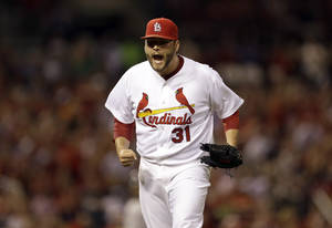 Photo - St. Louis Cardinals starting pitcher Lance Lynn celebrates after getting New York Yankees' Yangervis Solarte to ground into a double play, ending the top of the fourth inning of a baseball game Tuesday, May 27, 2014, in St. Louis. (AP Photo/Jeff Roberson)