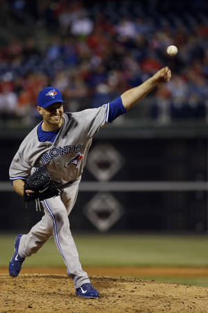 Photo - Toronto Blue Jays' J.A. Happ piches during the third inning of an interleague baseball game against the Philadelphia Phillies, Monday, May 5, 2014, in Philadelphia. (AP Photo/Matt Slocum)