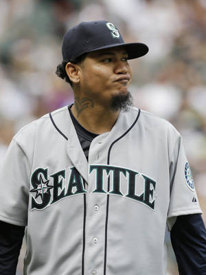 Photo - Seattle Mariners starter Felix Hernandez reacts as he walks back to the dugout  during the eighth inning of a baseball game against the Chicago White Sox Seattle Mariners in Chicago on Saturday, July 5, 2014. (AP Photo/Nam Y. Huh)