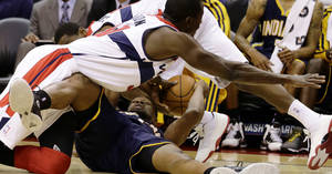 Photo -   Washington Wizards center Earl Barron, top, dives for the ball as Indiana Pacers forward Sam Young holds on to it, during the first half of an NBA basketball game Monday, Nov. 19, 2012, in Washington.( AP Photo/Alex Brandon)