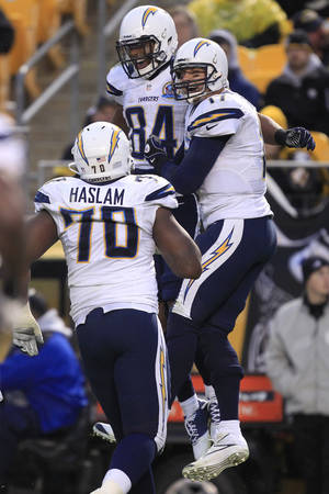Photo - San Diego Chargers quarterback Philip Rivers (17), right,  and wide receiver Danario Alexander (84) celebrate after Alexander made a catch of a Rivers pass for a touchdown in the fourth quarter of an NFL football game against the Pittsburgh Steelerson Sunday, Dec. 9, 2012, in Pittsburgh. The Chargers won 34-24. (AP Photo/Gene J. Puskar)