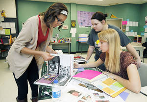 Photo - Staffers Kysha Miller, left, Destini Riley and Adrianna Doyal work on the Santa Fe High School yearbook. Photo by Paul Hellstern, The Oklahoman