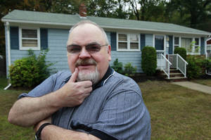 photo -   In this Wednesday, Oct. 3, 2012 photo retired social worker Jim Gillis stands in front of his home in Warwick, R.I. Gillis was told his $36,000 Rhode Island state pension would increase by $1,100 next year to keep up with inflation. But lawmakers suspended annual increases, leaving Gillis wondering how he'll pay medical bills and whether he'd been betrayed by his former employer. (AP Photo/Steven Senne)