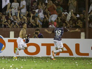 Photo - Victor Ayala of Argentina's Lanus, left, celebrates after scoring against Brazil's Ponte Preta during the Copa Sudamericana final soccer match  in Buenos Aires, Argentina, Wednesday, Dec. 11, 2013. (AP Photo/Eduardo Di Baia)