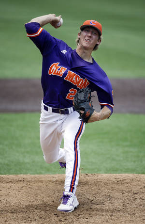 Photo - Clemson starting pitcher Daniel Gossett throws against Xavier during the third inning of an NCAA college baseball regional tournament game Saturday, May 31, 2014, in Nashville, Tenn. (AP Photo/Mark Humphrey)