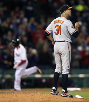 Photo - Baltimore Orioles' Ubaldo Jimenez (31) looks to the outfield as Boston Red Sox's Jonny Gomes (5), left, rounds third base on a three-run home run in the sixth inning of a baseball game in Boston, Sunday, April 20, 2014. (AP Photo/Michael Dwyer)