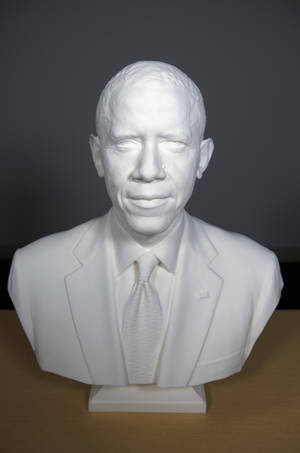Photo - This undated handout image provided by the Smithsonian Institution shows  the first presidential portrait created from 3-D scan data. A team at the Smithsonian Institution has created the first 3D presidential portraits to depict President Barack Obama in the National Portrait Gallery collection. Digital imaging specialists have created a 3D printed bust and life mask of Obama. Both were shown for the first time Wednesday at the first ever White House Maker Faire with a gathering of inventors and students. (AP Photo/Smithsonian Institution)