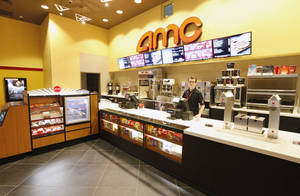 Photo - Kenneth Thacker, AMC Theatre senior manager, stands at the remodeled concession counter in the AMC theater at Penn Square Mall. <strong>PAUL B. SOUTHERLAND - PAUL B. SOUTHERLAND</strong>