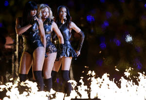 Photo - Beyonce, center, Kelly Rowland, left, and Michelle Williams, of Destiny's Child, perform during the halftime show of the NFL Super Bowl XLVII football game between the San Francisco 49ers and the Baltimore Ravens, Sunday, Feb. 3, 2013, in New Orleans. (AP Photo/Marcio Sanchez)