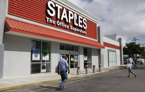 Photo - FILE - A Staples office supply store is photographed in this Nov. 15, 2011 file photo taken in Miami. The office products company also announced Wednesday March 6, 2013 that it is increasing its quarterly dividend by 9 percent.  (AP Photo/ Lynne Sladky, File)
