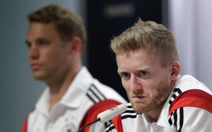 Photo - German national soccer player Andre Schuerrle, foreground right, attends a news conference besides teammate goalkeeper Manuel Neuer in Santo Andre near Porto Seguro, Brazil, Wednesday, July 2, 2014. Germany faces France on upcoming Friday in Maracana Stadium in Rio de Janeiro, in the quarterfinals of the World Cup. (AP Photo/Matthias Schrader)