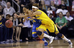 photo - UCLA's Mariah Williams (14) and California's Layshia Clarendon chase a loose ball in the first half of an NCAA college basketball game in the Pac-12 Conference tournament Saturday, March 9, 2013, in Seattle. (AP Photo/Elaine Thompson)